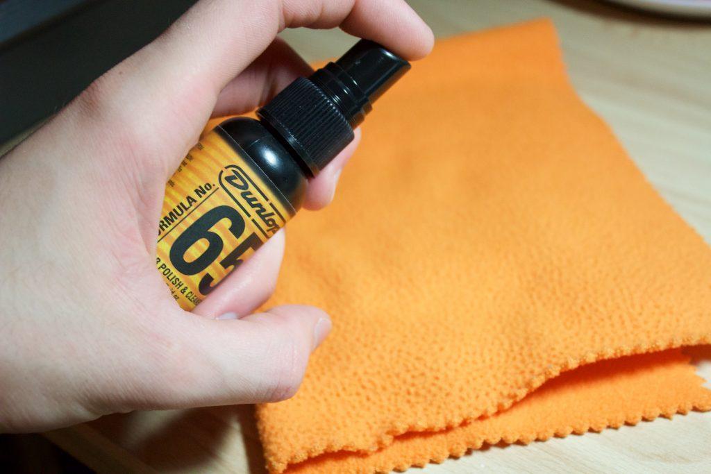 Dunlop 65 Guitar Polish sprayed onto cloth