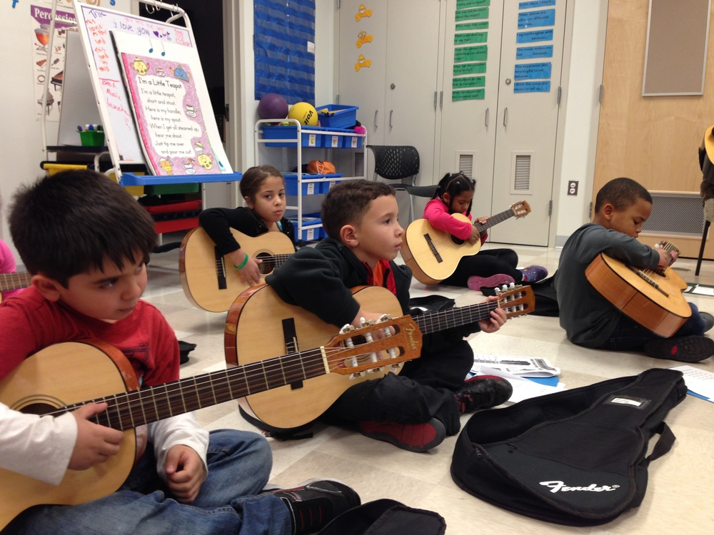 Children Learning Guitar - Andertons Music Co.