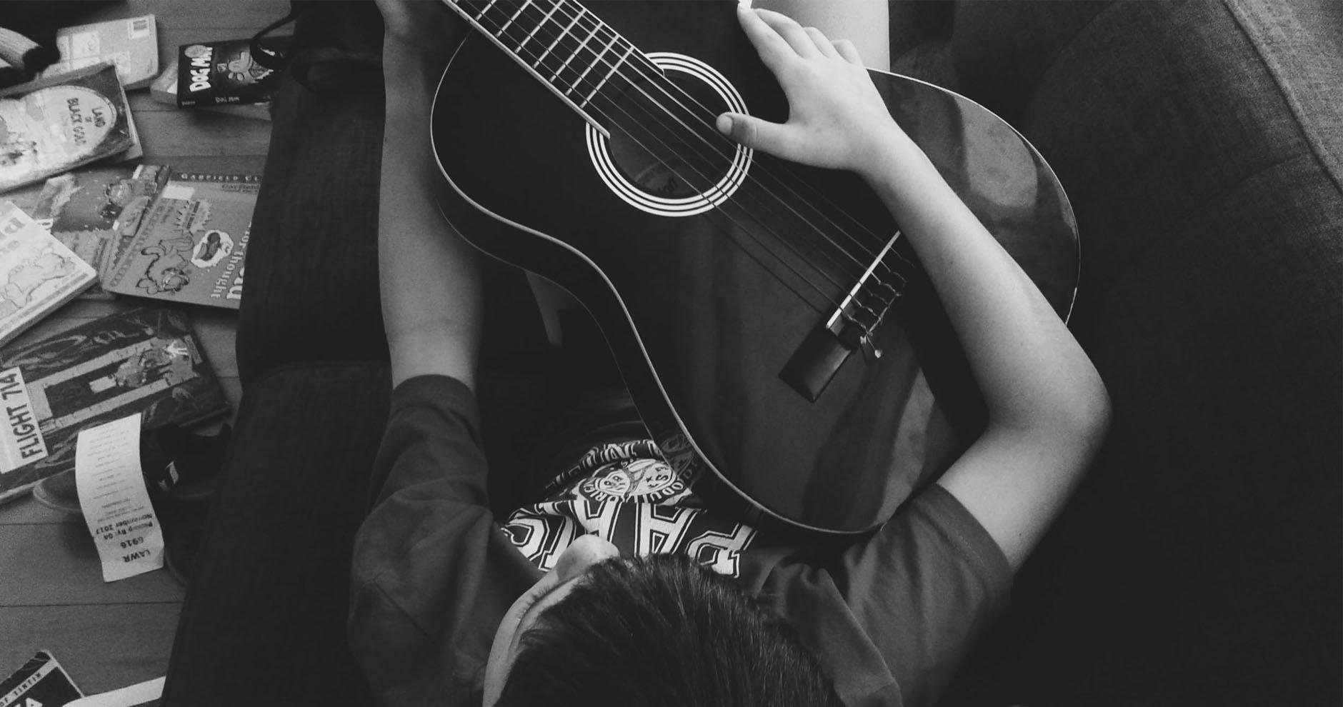Boy acoustic guitar